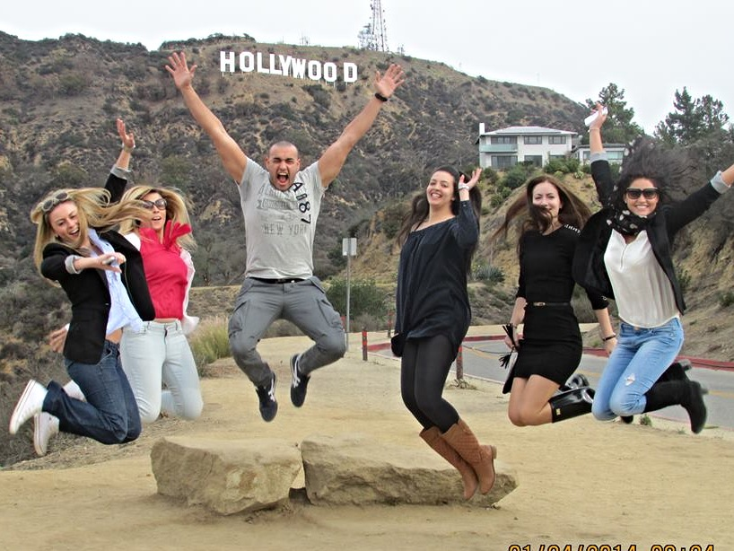 Tour group jumping at Hollywood Sign