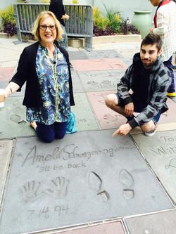 Couple at Schwarzenegger handprints