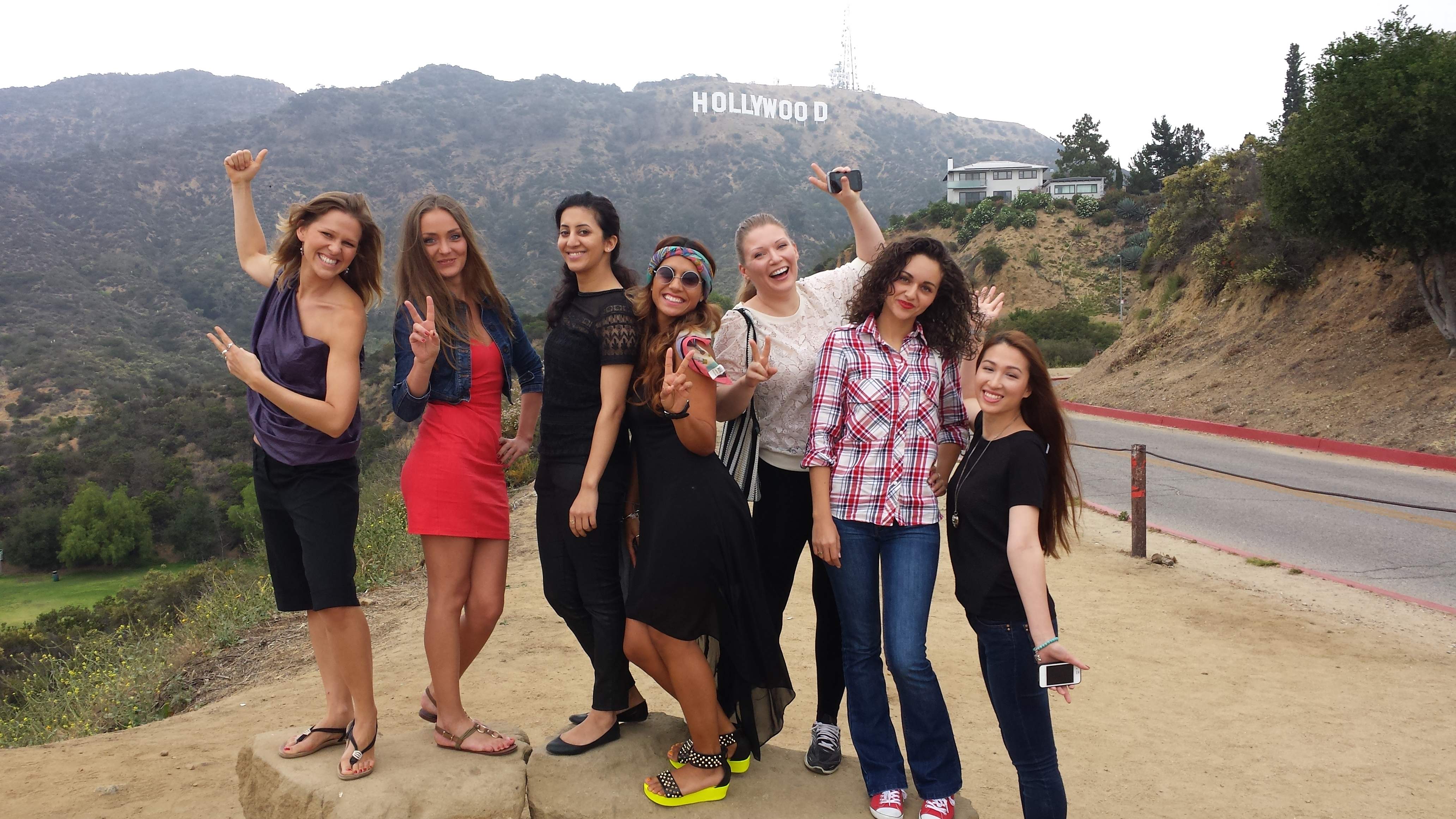 Excited friends near Hollywood Sign