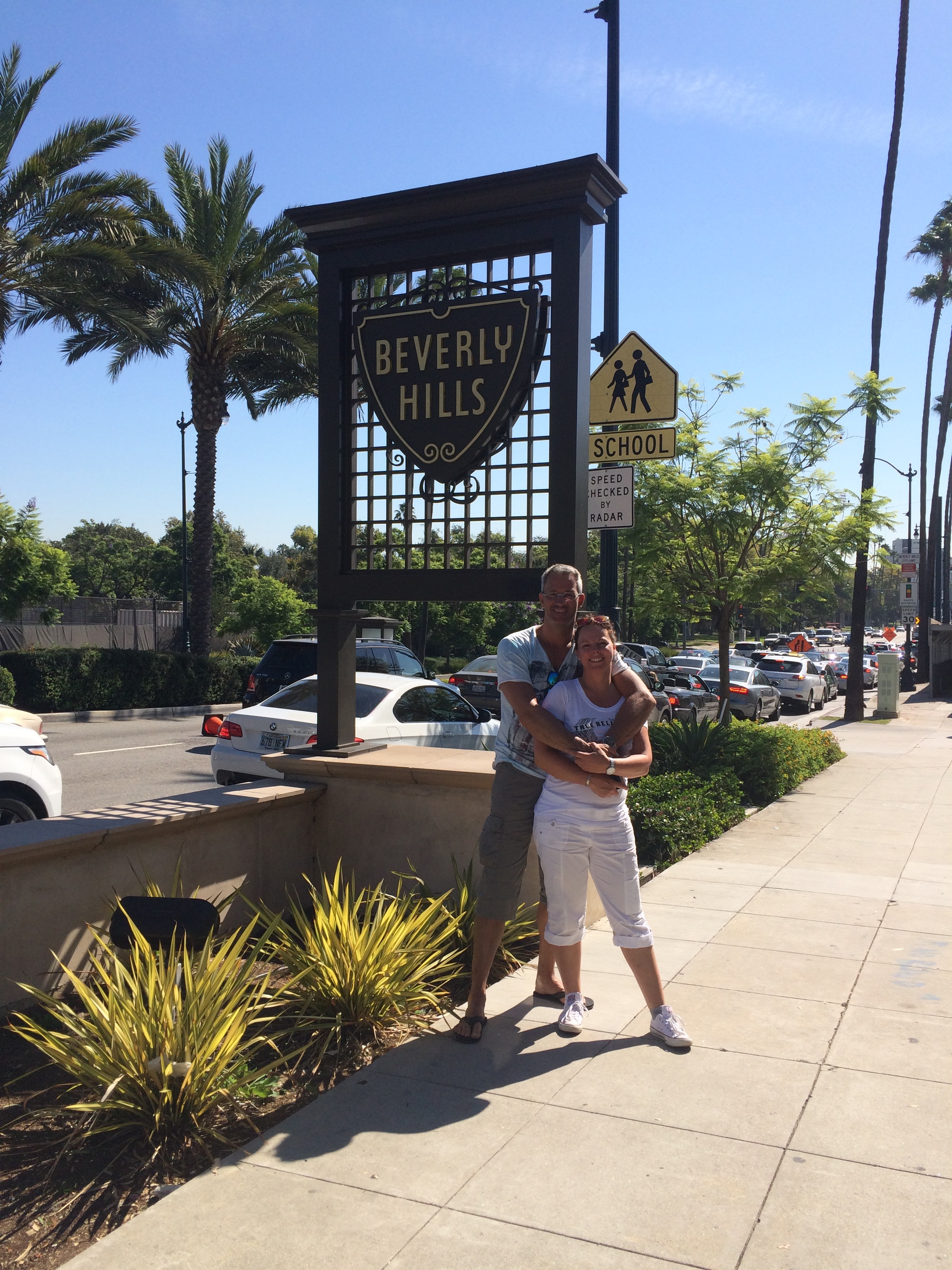 Couple next to Beverly Hills Sign