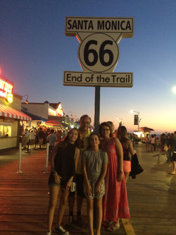 Family at Route 66 Sign at the beach