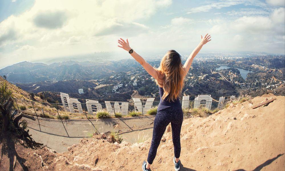 Girl enjoying view behind Hollywood Sign