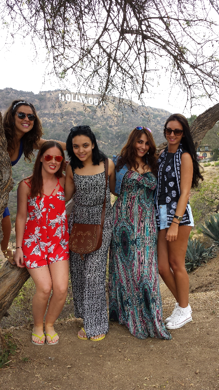 Five girlfriends near Hollywood Sign