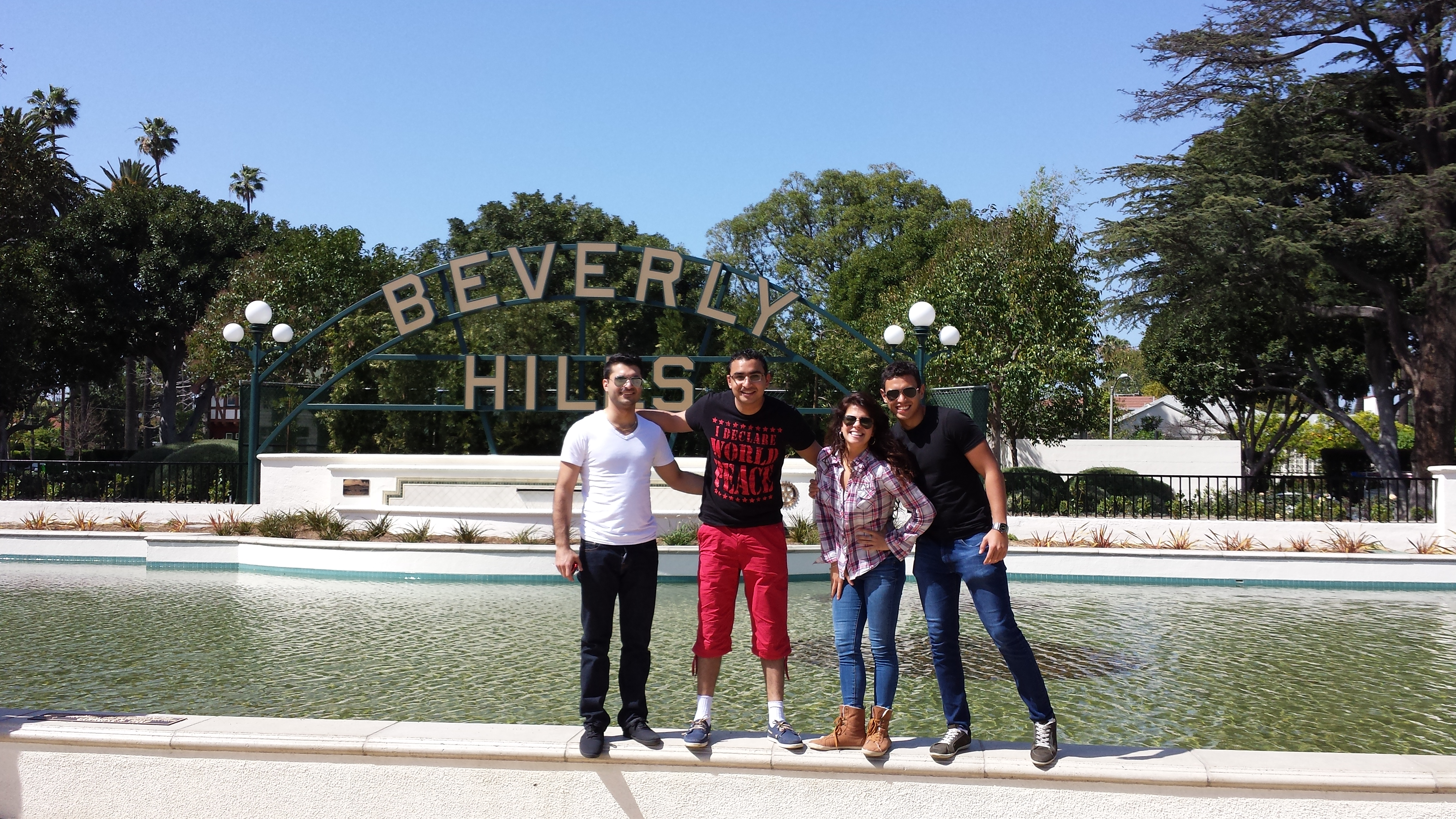Tour group at Beverly Hills sign