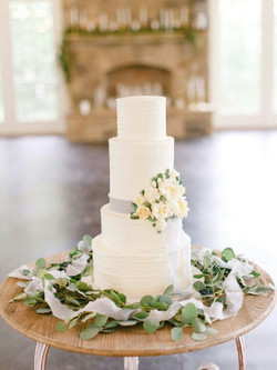 textured cake with buttercream flowers