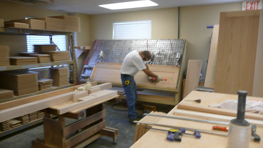 Woodworking in the Murphy bed factory