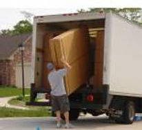 Murphy bed delivery taking package off truck