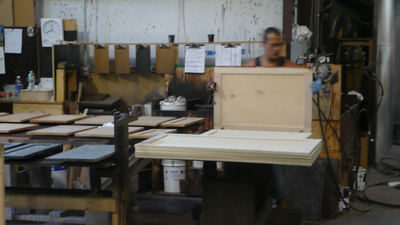 Finishing wood panels in the Murphy bed factory