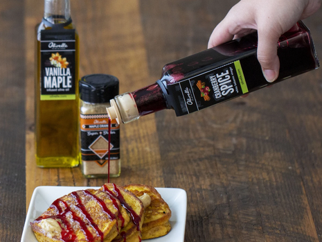 Pumpkin Pancakes with Spiced Butter & Cranberry Drizzle