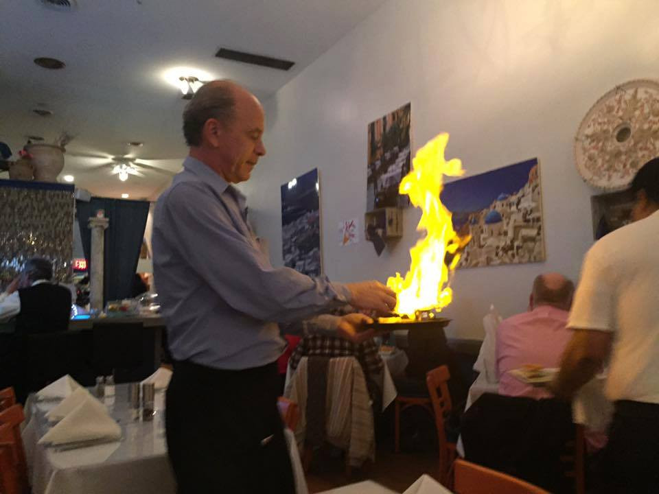 Kosta Igniting The Saganaki Cheese