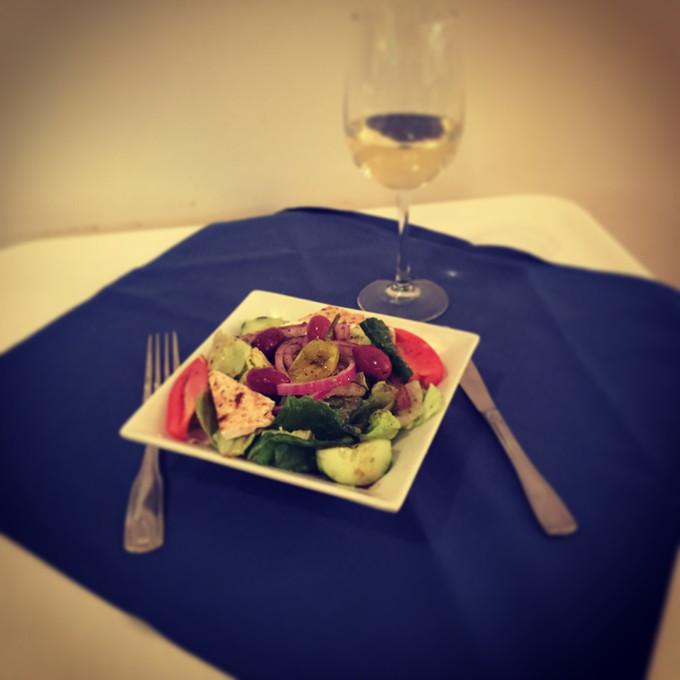 Enjoy a Kokonisto Leg of Lamb or a Beautiful Elliniki Dinner Salad at Papaspiros!