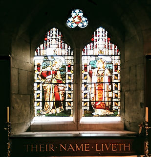 Window at St Saviour's showing The Good Shepherd (left) and Christ the Redeemer (right)
