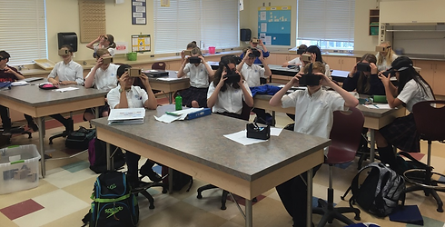 Students using head sets.png