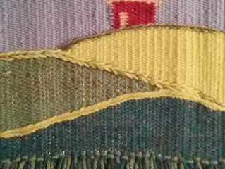 Working on weaving samples for a workshop