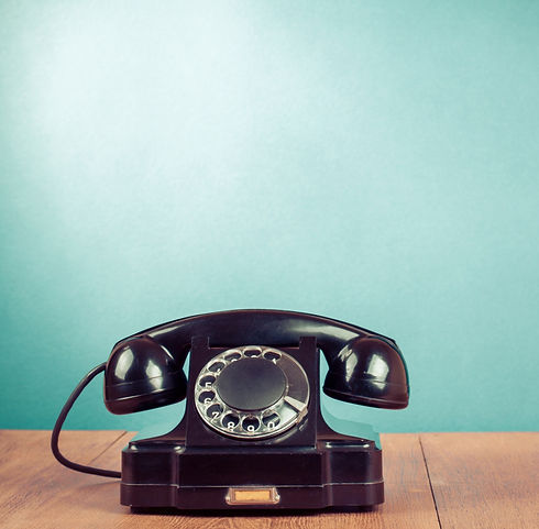 Retro black telephone on table in front mint green background_edited_edited.jpg