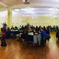 Students fill the room for the Reflect Dinner.