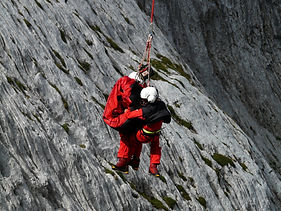 Canva - Two People Rappelling Near Grey