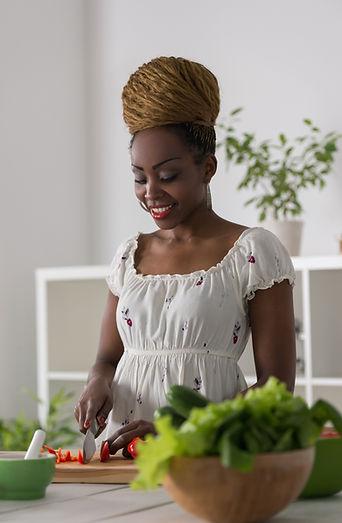 BLack woman preparing food smaller shutt