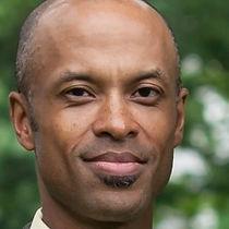 Headshot of Gerard Etiene, Co-Founder & Principal
