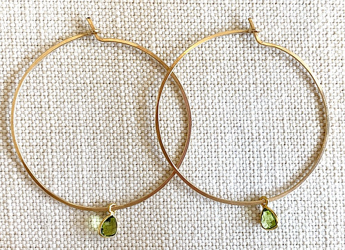 Gold hoops with green crystal charm