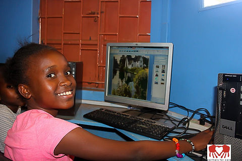 Computer School Girl with Computer Smiling_edited.jpg