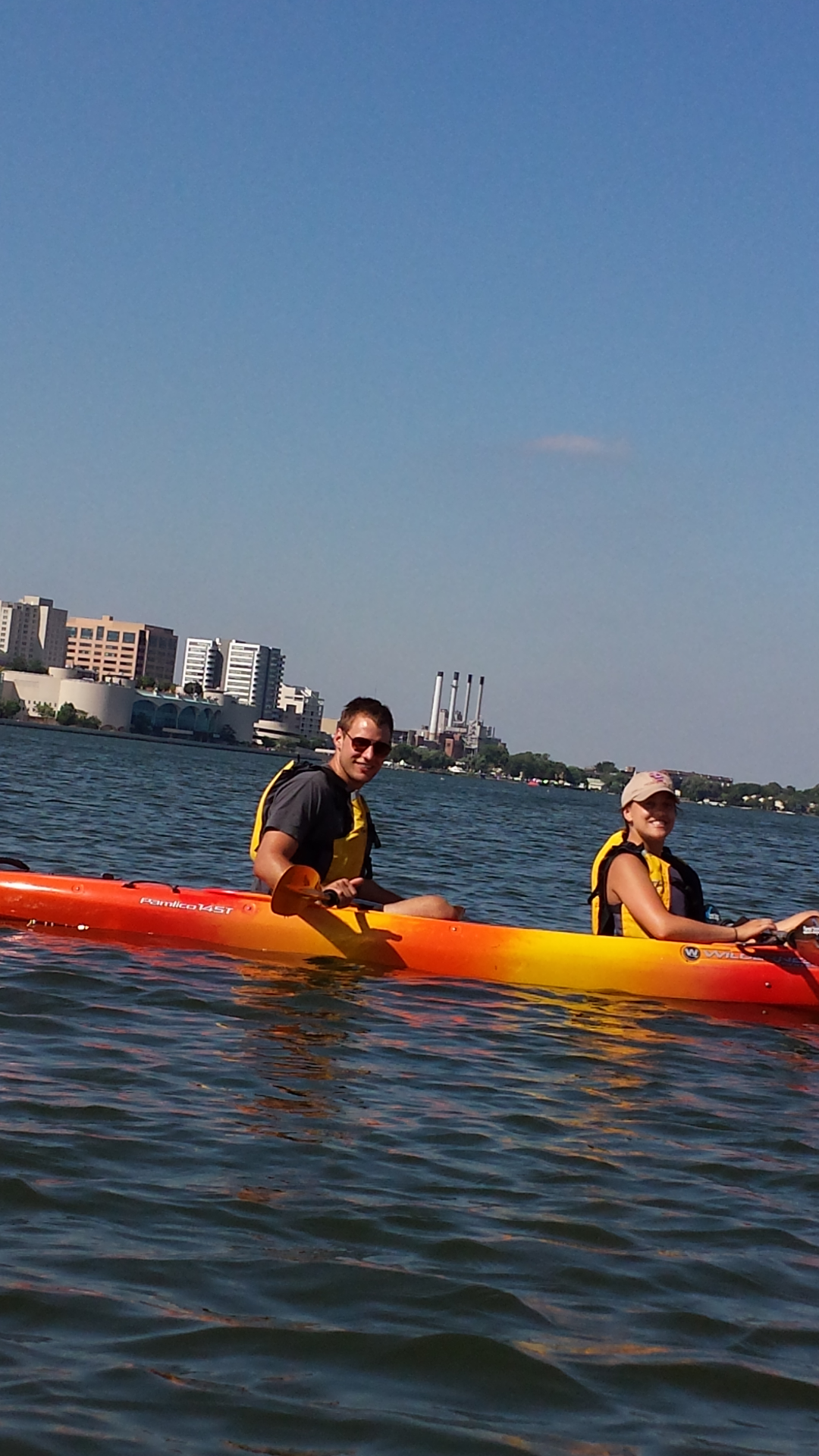 Students paddling with Stacy