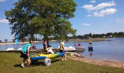 Member using kayak and chariot