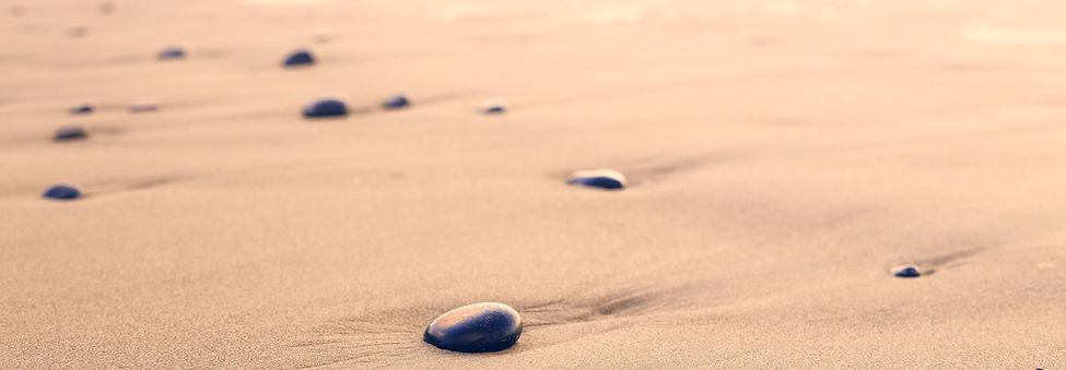 Stones on a sandy beach
