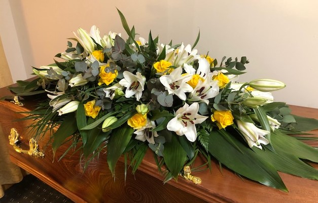 LILIES & ROSES COFFIN SPRAY £125