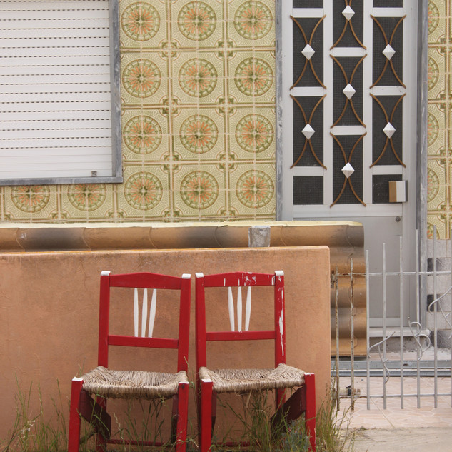Tile House with Two Chairs