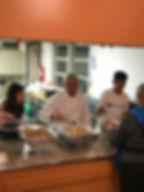 youth volunteers serving dinner.jpg