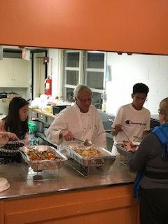 youth volunteers serving dinner.jpg
