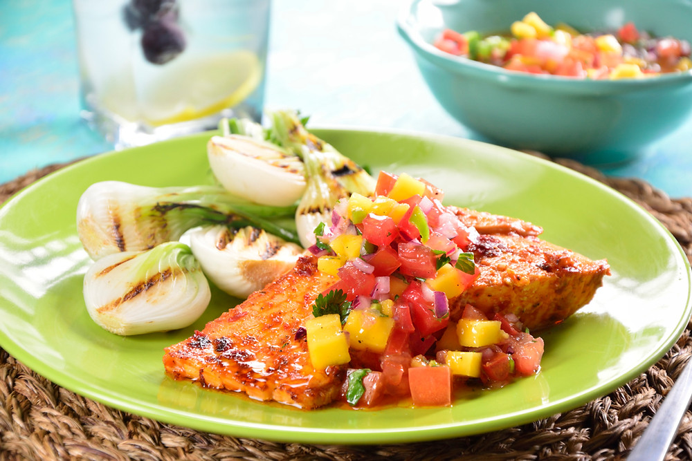 Baked salmon marinaded in Hawt Mess served withMANGO PICO DE GALLO