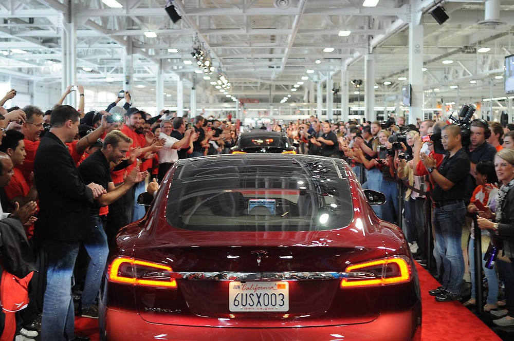 Red Tesla in show room event public offering