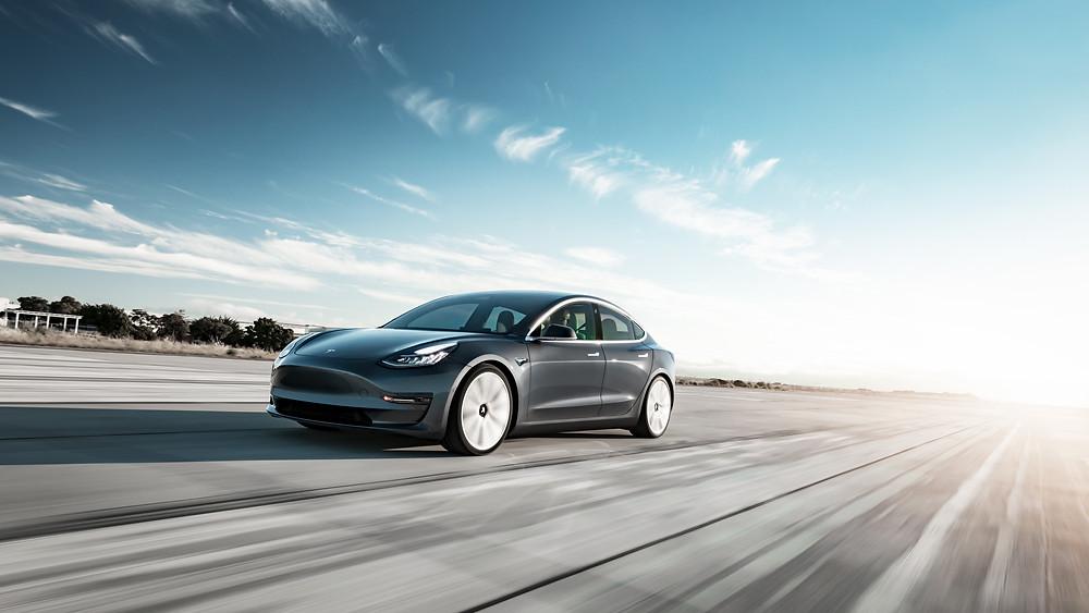 Tesla model 3 press release picture black elon musk action shot