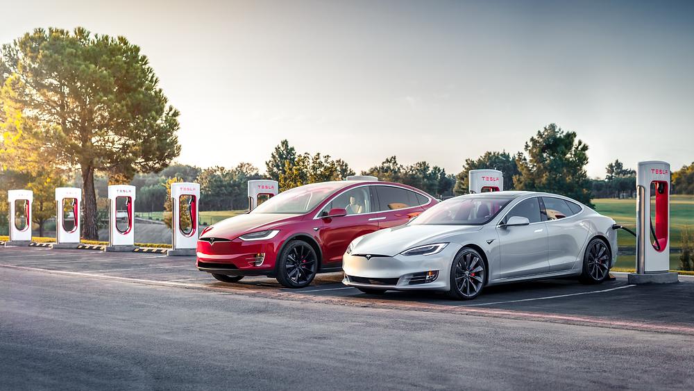 Tesla model S tesla model y super charger station white and red