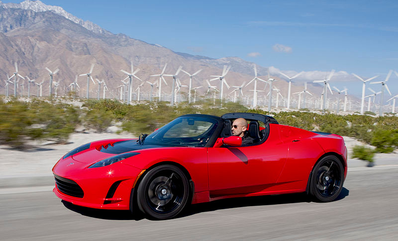 First production Tesla Roadster red driving countryside