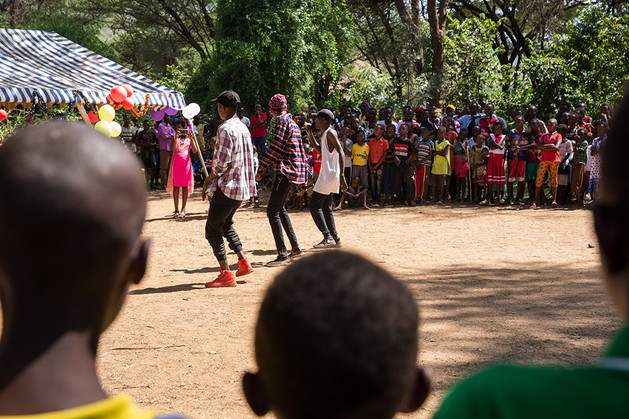 Young boys performing a dance at Kenya wedding
