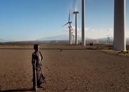 boy in front of Kengen wind farm near lake turkana
