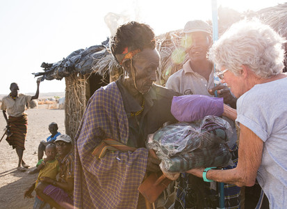 Giving gifts to the villagers in Lake Turkana Kenya