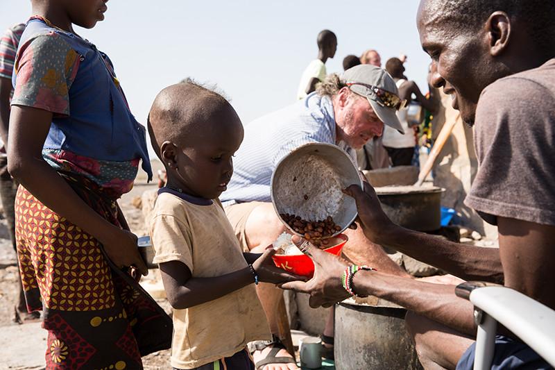 serving-boy-lunch-kenya.jpg