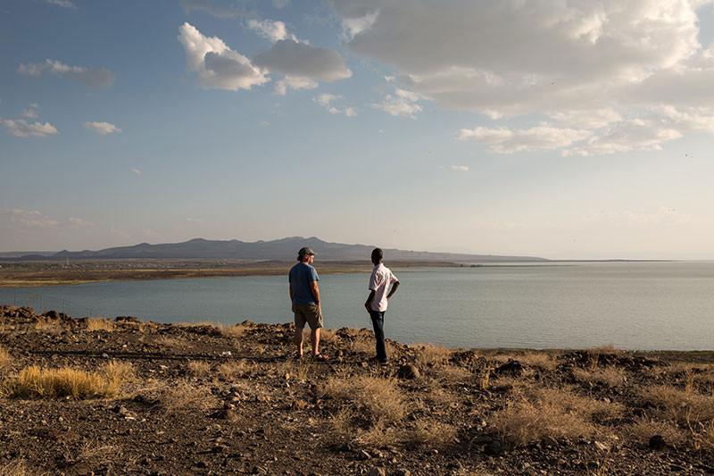 friends posing at sunset on the shores of Lake Turkana in Kenya
