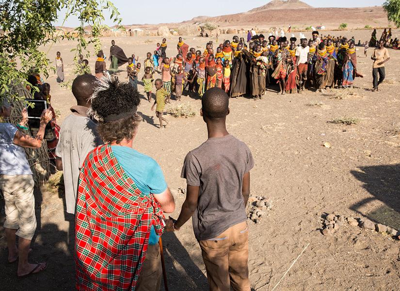 villagers dancing in Lake Turkana in Kenya