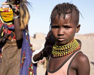young girl from Lake Turkana in Kenya wearing beads