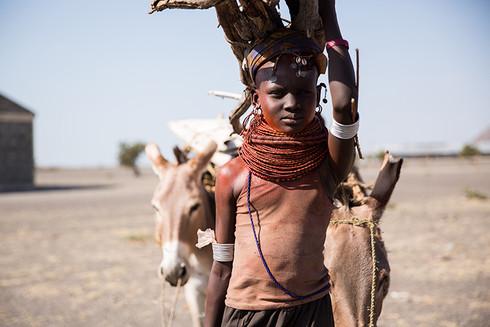 girl-gathering-firewood-kenya.jpg