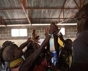 Playing games with children in Lake Turkana Kenya
