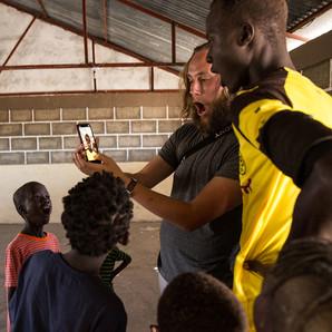playing iPhone games in remote Kenya