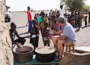 feeding children in Moite village in Kenya