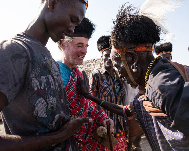 Lake turkana elder performing traditional water ceremony