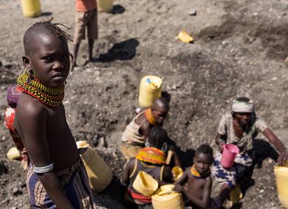 Children digging for water in Lake Turkana Kenya